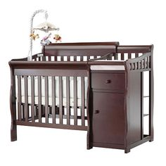 Cute mini of crib with changing table.