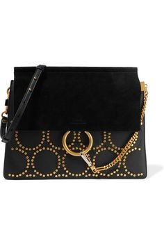 This simple but elegant studded leather bag completes any look.