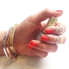mixed metals, knuckle rings, orange nails.