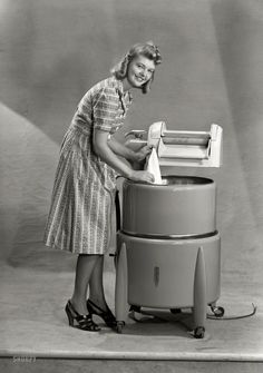 "New Zealand circa 1950s. ""Model with wringer washing machine."" I am Woman, see me Wash. Photo by Gordon Burt Studio (Well, nest time I want to whine about doing laundry, I'll remember this...)"