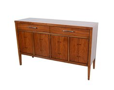 Lane Tuxedo Credenza no. 228-62 Buffet Gunstock Walnut Walnut with rosewood butterfly joints and ebony inlaid lines. Condition- Good vintage condition. Original surface. Minor wear typical of a vintage piece. Structurally Sound. Please look at the images for condition. Measures- 48l x 15d x 30h Ships freight to the curb nationwide for $ 229. Some rural locations maybe a little more please inquire.