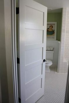 love this door >> and so simple too! Watch out bathroom door, I'm coming for you! ;)