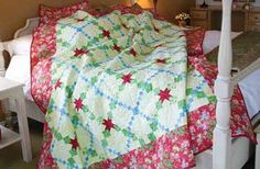 Scarlet Garden Quilt Kit: Simple pieced chains and strips create a lovely star design on this gorgeous Scarlet Garden bed quilt designed by Gerri Robinson.