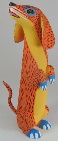 Oaxacan = ремесло в Мексике, резьба по дереву. вырезаются фигурки, а потом раскрашиваются прекрасными узорами