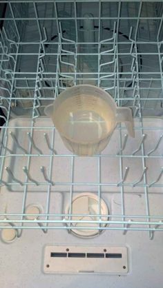 Put a cup of vinegar in the top rack of your dishwasher and run on the hottest cycle.