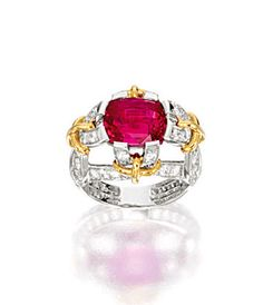 RUBY AND DIAMOND RING, TIFFANY & CO.    Centring on a cushion-shaped ruby weighing 5.39 carats, to a stylised shank set with brilliant-cut diamonds, mounted in 18 karat white and yellow gold, signed.
