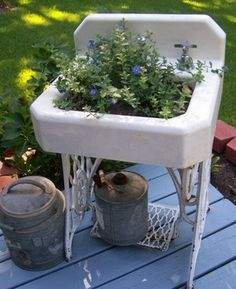 14 DIY Gardening Tips & Projects - Turn an old sink into a planter.