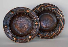 From the Estate of Cyril Lander                Two Hammered Arts & Crafts Style Copper Wall Plates