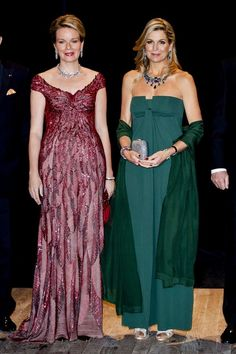 The Queen of Belgium and the Queen of the Netherlands attend a concert on November 29, 2016.  The Queen of Belgium is wearing her Laurel Wreath tiara as a necklace with another new gown.