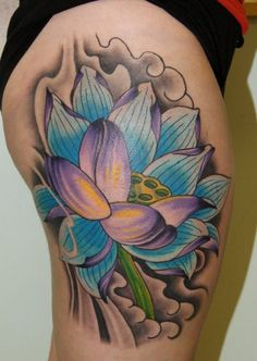 Blue and purple lotus flower tattoo by Anthony Filo @ White Tiger Tatto, Rochester, NY