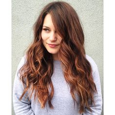 Rich auburn and deep brunette pair perfectly in this long, wavy balayage by Aveda stylist Jenna.