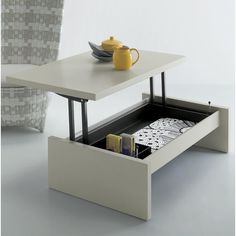 The versatile Cosmo converts from a coffee table to a taller table or a desk with container space.  With easy opening and closing, the Cosmo is very stable even in the open position.