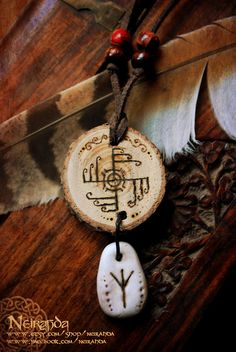 Cool Icelandic necklace with ancient symbols...     neirahda: Ginfaxi Icelandic Necklace, available here:https://www.etsy.com/listing/109278318/ginfaxi-icelandic-necklaceGinfaxi is one of the Icelandic symbols with magical effects that have been preserved until our days. It provides protection and victory in battle, and the Icelandic warriors kept this symbol in their shoes when they went to battle.Algiz (or Elhaz) is a magic rune of the