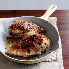Grilled Chicken Breasts with Lemon and Thyme | A bold mixture of red-pepper flakes, garlic, thyme, lemon juice, and olive oil serves as a spicy marinade for bone-in chicken breasts. If you want your chicken spicier still, increase the red pepper or leave the breasts in the marinade for an hour or two.