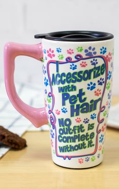Proclaim your pet hair fashion statement with this festive ceramic travel mug. As colorful as your character, with convenient lid and handle, no day is complete without this handy hot liquids carrier -- or the pet hair in your wardrobe.