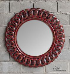 Uttermost Sassia Mirror. Frame is made from carved, solid mango wood finished in heavily distressed, aged red with black accents.