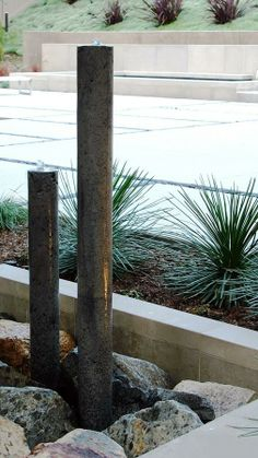 "Fountain made by pouring concrete into 4"" PVC pipes with thin copper pipe for water, Debora Carl"