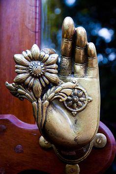 Intricate door knob in the Dwariki's Hotel, Kathmandu, Nepal - Mudra (Hindu or Buddhist hand position) with flower.
