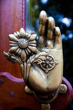Intricate door knob in the Dwariki's Hotel, Kathmandu, Nepal - Mudra (Hindu or Buddhist hand position) with flower.