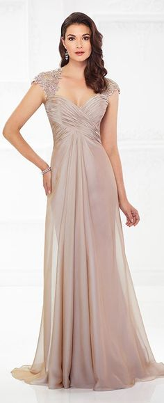 Ultra-flattering and timeless, this two-tone chiffon A-line gown offers hand-beaded scalloped Venise lace cap sleeves that continue to a back keyhole, a Queen Anne neckline, a crisscross ruched empire bodice, and a center front and back gathered skirt with a sweep train. A matching shawl is included.