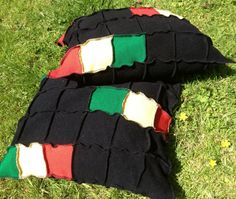 """Pair of 2 Upcycled Cushions for Reggae Fans and Rastafarians. Black, with red, gold, green.18""""x 18"""",Quality upcycled knitwear. UK Seller"""