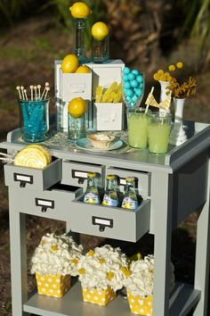 Spring-y lemon and aqua candy bar.-- change the colors of course, but wonder if I could find a piece of furniture like this?