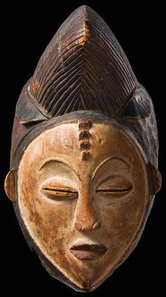 Punu mask, cf Maurice Tabard's photo in 1936
