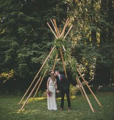 Summer Solstice Wedding with a teepee ceremony backdrop