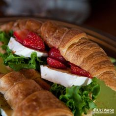 Croissant with brie, strawberries and gooseberry jam