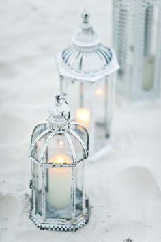 White-washed lanterns. The perfect beach side wedding decor;) Photo by Style Art Life