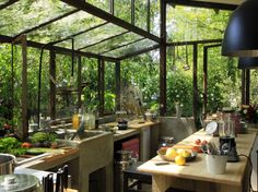 greenhouse kitchen - I cannot for the life of me find the original source for this photo.