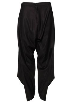 Immersed in fabric, this Autumn/Winter 2013-14 sees the creation of Vivienne Westwood's harem trousers. In classic black with a geometric cut, these stylish trousers are crafted with a wool and silk blend. Pocketed and with a drop crotch, zipped fly, the back of the waistband comes with elasticated detail creating a ruched effect. With cutaway detailing at the cuffed ankles, this garment in finished with a single black engraved 'Vivienne Westwood' button.