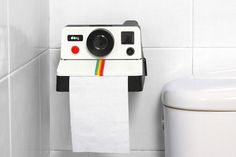 Flashback to the in your bathroom with this Polaroid toilet roll holder. Give your guests something to chuckle about with this toilet paper holder which looks just like a Polaroid camera, but this one dispenses toilet paper instead of film. Paper Roll Holders, Toilet Paper Roll Holder, Tissue Holders, Toilet Paper Dispenser, Retro Camera, Decoration Originale, Unusual Gifts, Tissue Boxes, White Elephant Gifts