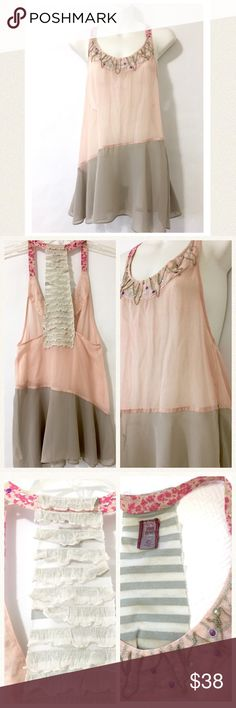 "Free People ultra-feminine beaded halter top Accessories not needed when wearing this delicate, lovely top. Scoop neck and straps have exquisite sparkly beading. The back is a rough cut ruffled panel. Pink and grey in an asymmetrical design creates a flowy and feminine top. Fabric includes cotton/poly/spandex but the pink and grey area is a thin chiffon like cotton. Excellent condition.  🔹bust 28"" 🔹length 27"" Free People Tops"