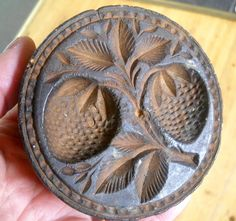 Antique butter stamp with hand carved strawberry and leaf decoration. A few nicks and bumps over the years but generally nice original uncleaned condition. Sold 10/6/14 on ebay for $53.