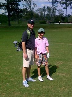 Luke with his Dad caddying.