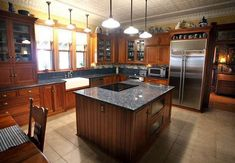 Kitchen Featuring Custom Cherry Cabinets, blue pearl granite countertops & a tin ceiling. #kitchen #farmhouse