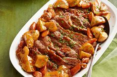 Oven BBQ Brisket-  1 beef brisket (4 lb.)  1 onion, thinly sliced  1cup KRAFT Original Barbecue Sauce  2lb.red potatoes (about 6), cut into 1-1/2-inch chunks  1lb.carrots, cut into 1/2-inch-thick slices
