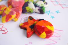What do you do with left over bits of crayons?  Get a mold, cut them into small pieces, put them in the mold, bake them for 10 minutes @ 200F, take out, cool and you have new crayons that are cool shapes that the kids love!!