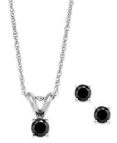 The perfect match to your LBD. This jewelry set includes a pendant necklace and stud earrings bejeweled with round-cut black diamond accents. Total carat weight: 1/6 ct. t.w. Set in 10k white gold. Approximate length: 18 inches. Approximate drop: 1/8 inch. Approximate diameter: 1/8 inch.