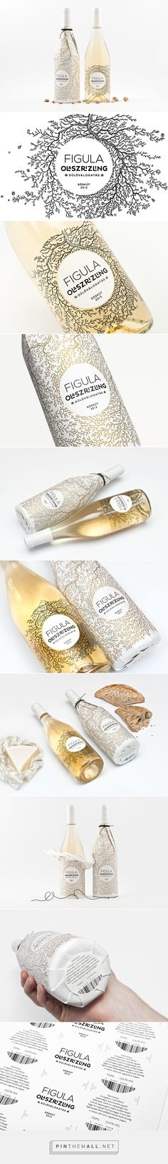 Graphic design, illustration and packaging for Figula Olaszrizling 2013 Wine Label Design on Behance curated by Packaging Diva PD.  Focus mainly on the 35-year-old roots, which enmeshes the bottle defining a circle that marks the location of the typography. Beautiful.