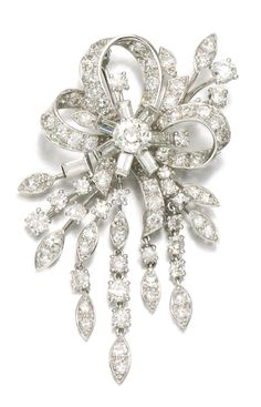 DIAMOND BROOCH, MONTURE CARTIER, 1960S Of floral and ribbon bow design with diamond fronds suspended below, set with circular-cut and baguette diamonds, inscribed monture Cartier.
