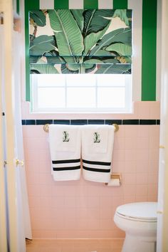 Bathroom, pink vintage tile, green painted stripe, banana leaf Design by Bailey McCarthy photo by Kimberly Chau