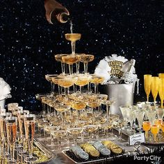 15 elegant New Year's Eve party ideas: A & champagne tower and more glam ideas in black, silver, and gold. Masquerade Party Decorations, New Years Eve Decorations, New Year's Eve Masquerade Party, Elegant Party Decorations, Roaring 20s Party, Gatsby Themed Party, Nye Party, Gold Party, New Year's Eve Party Themes