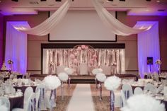 As You Wish Floral Design: Early Spring Wedding at the Hy-Vee Conference Center. Ceremony and reception in same room.
