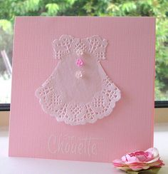 https://flic.kr/p/nDhe4n | C'est Chouette | I am still waiting for my first grand daughter to arrive - should be sometime in June, so in the mean time I cut out a dress freehand from a doily, on a pink cardbase. I couldn't find my sentiment 'Un jour à celebré', so I had to go with this one, which means - It's great..., it is a Hero Arts sentiment. I hope she likes it. By the way I got this idea from Pinterest.