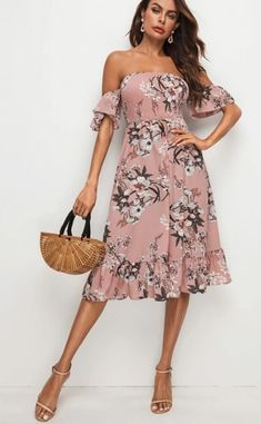 Light blush dress with white, pink, & grey-green floral print. Falls just below the knee. Flounce sleeve and hem with elastic band top.