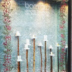 Found wood plinths like tiny bird tables with hand drawn garland and backdrop by @lucyauge for Bamford Skincare launch as Fenwick Bond Street. @fenwickbondst @bamfordjournal