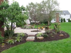 Great back yard patio landscaping idea.  Relax more by adding long lasting rubber mulch to eliminate the job of annual mulching.