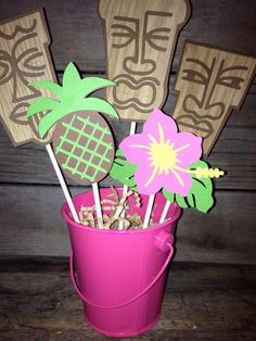 Luau Aloha Themed Centerpiece Ready To SHIP today Tiki Man Pineapple Hibiscus Flower Pink yellow hawaiian. $16.50, via Etsy.